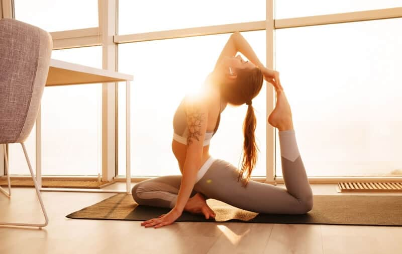 Girl doing yoga at home - Yoga download review